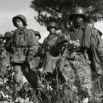 An integrated Army unit of African American, White, and Korean Soldiers in November of 1950 in Korea.  Photo/U.S. Department of Defense 60th Anniversary of the Korean War Commemoration Committee